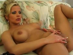 MILF Adrianna Russo rubs her shaved pussy on a sofa tube porn video