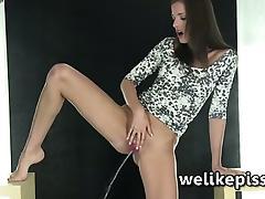 Silvia Luca in erotic piss play