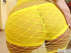 Her perfect ass peaks out through a sexy fishnet.