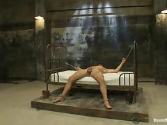 A tied up dude gets gangbanged by muscled dudes