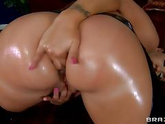 Kelly Divine toys her oiled holes and gets her butt fucked from behind