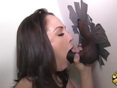 Kristina Rose sucks on a big black cock through a gloryhole tube porn video