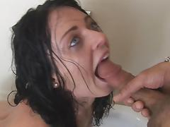 Brunette Sophie Dee is giving a deep blowjob
