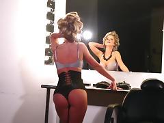 Kimber Cox wears a sexy corset in solo scene tube porn video