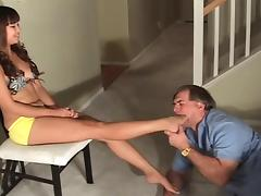Young asian girl laughs at her old foot slave