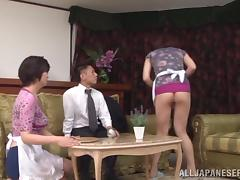 Asian hottie are fucked by a guy in a threesome