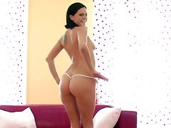 Naughty brunette seductress strips on cam and masturbates