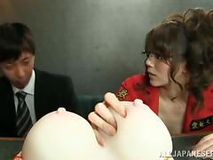 Horny Asian milf pleases a guy with a blowjob and a titjob