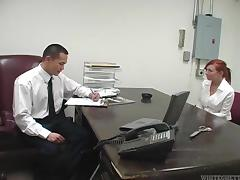 Tattooed redhead secretary knows how to relax her boss
