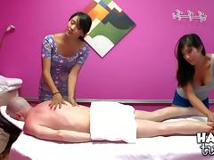 Asian masseuses share a client's big cock in a threesome
