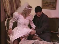 Horny bride sucks on a hard cock before being fucked