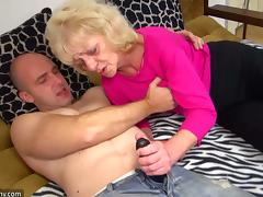 Cock-Hungry Granny Wanks A Horny Guy With A Strap-On