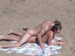 Sexy couple is fucking on the sand