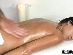Big dicked masseur fucks a slippery brunette