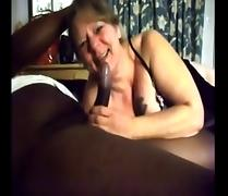 White Granny gives blowjob to BBC