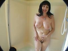 Busty brunette skank blows erected cock in the bathroom