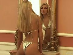 Blonde bombshell poses for the cam in her golden bikini tube porn video