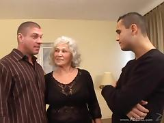 Two Hot Sexy Dudes Fuck A Horny Grannma On The Bed