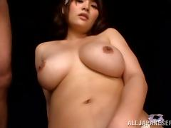Busty milf Meguri fingers her Asian cunt in front of many men