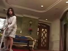 Asian Housewife serves her Husband when he gets Home