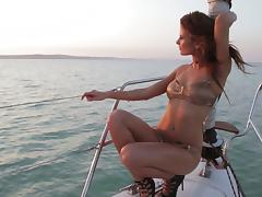 Sexy brunette shows off her sexy body while sailing on a boat tube porn video