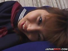 Japanese school girl making her pussy wet with a vibrator
