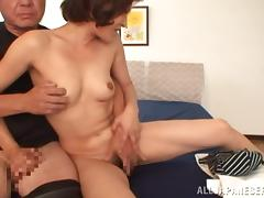 Japanese tart licks a guy's balls and takes a ride on his dick
