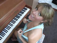 Sexy blonde Talia is playing on piano tube porn video