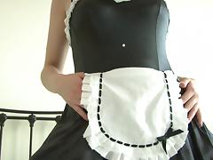Brunette wears frilly, seductive maid's uniform.. ooo spank me!