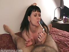 Amateur milf Mina smokes and gives a blowjob to a guy in POV clip