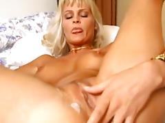 Glamorous blonde is sucking a nice pole