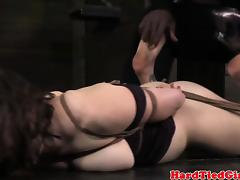 Hogtied and gagged sub tormented by dom