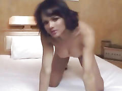Sexy brunette shemale babe sucking on a hard cock