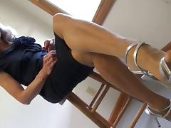 nylon feet and strappy heels dangle and soles