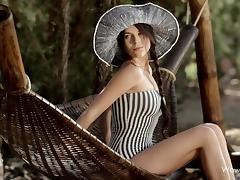 elegant beauty poses in the hammock