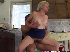 Slutty milf gets a facial after she rides the dick