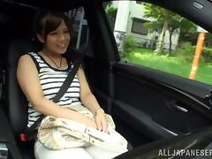 Japaneses Solo Model Posing Seductively In The Car