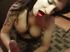 Busty MILF in stockings teases her clit with a magic wand