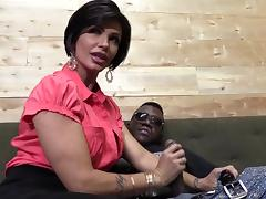 Winsome Brunette With Fake Tits Giving A Huge Black Cock Handjob