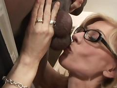 Blonde mom Nina Hartley wearing glasses enjoys interracial MMF sex tube porn video