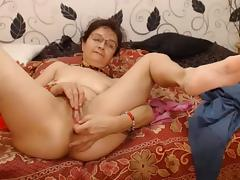 Hot grandma fingering her pussy and asshole