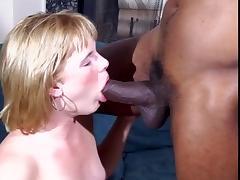 Mixed couple fucks hardcore on sofa