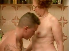 Granny gets fucked in the kitchen