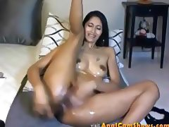 Hot asian babe gets fucked with a huge dildo