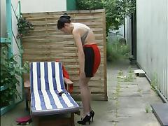 German mature Silke fucks herself outdoor