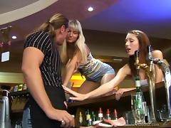 Two slutty chicks seduce a barman and fuck him in the club