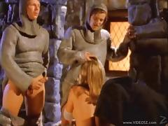 Medieval blonde Wendi gets fucked by two knights in MMF clip