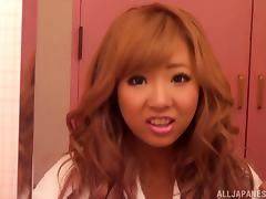 Sexy redhead Asian with biug tits in thong gets pussy waxed