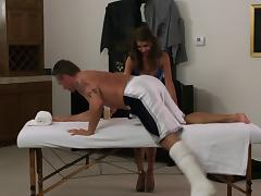 Sexy brunette with an awesome body enjoying a hardcore fuck on a massage table