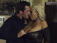 Her big, fake tits bounce as she rides this guy's hard cock